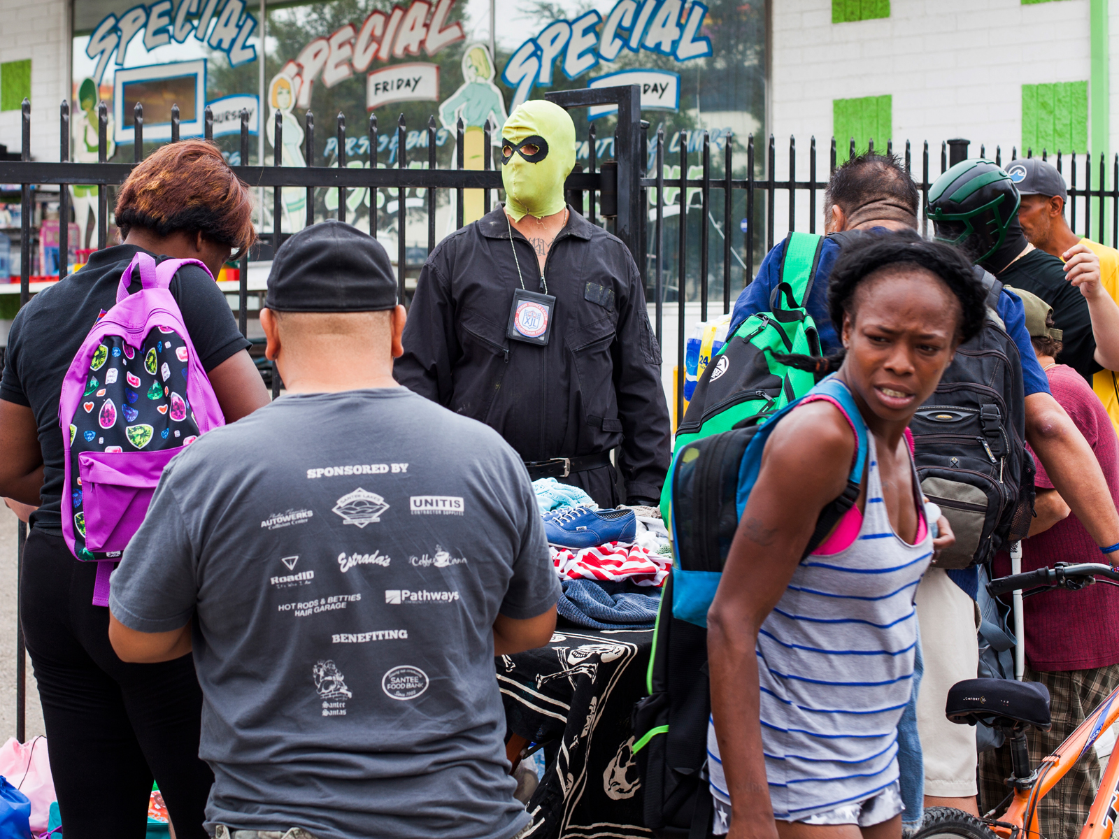 "Heavy Hitter giving out backpacks and clothes during ""Project Hope"""