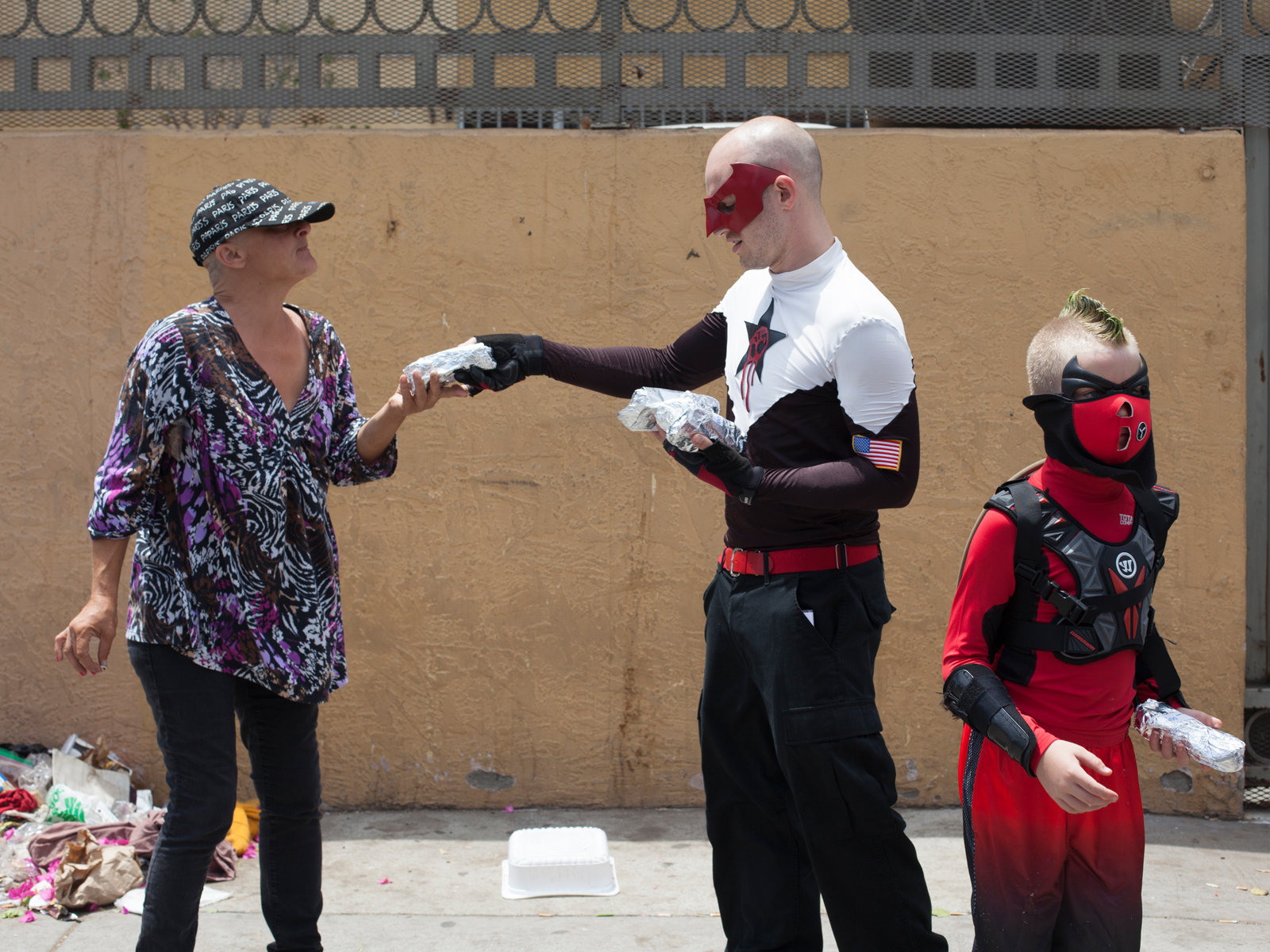 "Crimson Fist and Osprey handing out burritos for the homeless during ""Project Hope""."