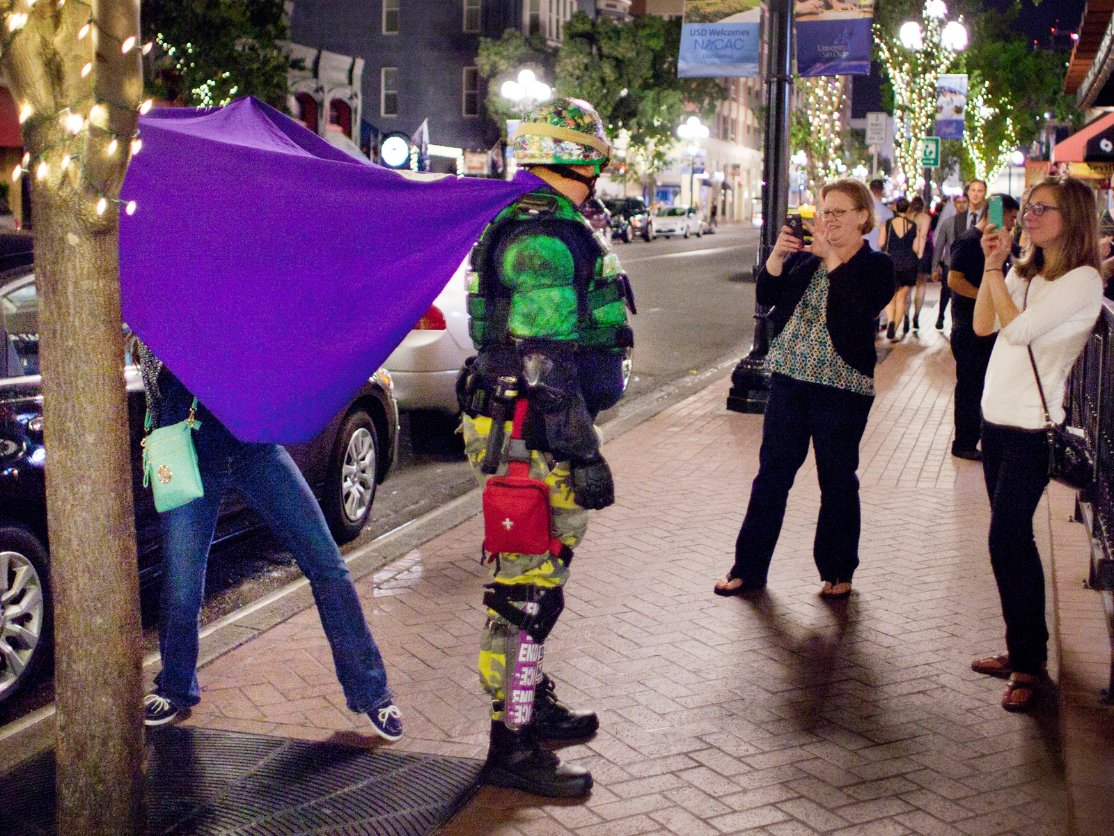 Posing for photos during a safety patrol in San Diego's gaslamp district which is the main party area with many bars and clubs.