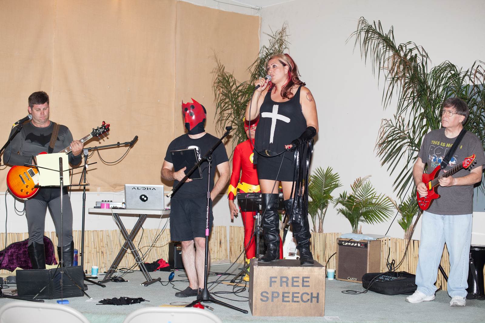 "Nightbug, Rock'N'Roll and two members from the ""Legacy Initiative"" in Salt Lake City (as ""The Flash"" and ""Batman"") performing at a fundraiser concert for ""Project Hope""."